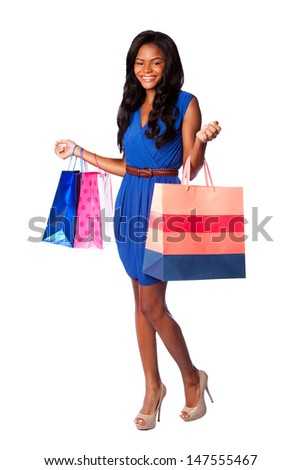 Beautiful happy smiling walking fashion consumer woman shopping with bags, wearing pumps, blue dress and belt, on white.