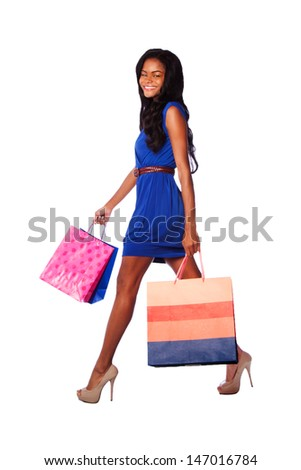 Beautiful happy smiling walking fashion woman shopping with bags, wearing heels pumps, blue dress and belt, on white. - stock photo