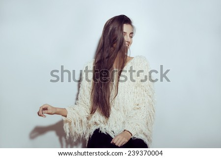 Beautiful happy smiling winter woman. Laughing girl . Home style clothes. White positive teenage sweater. Lifestyle. Hipster. - stock photo