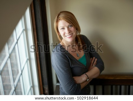 Beautiful happy smiling woman indoor portrait, focus on face - stock photo