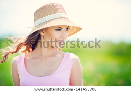 Beautiful happy smiling woman on summer meadow - stock photo