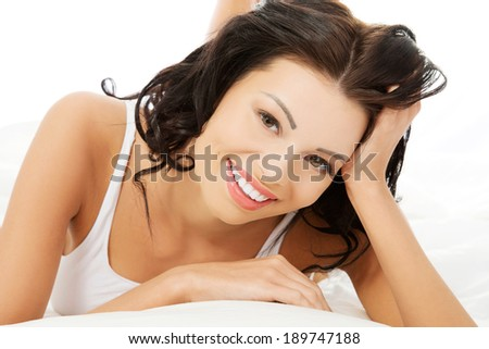 Beautiful happy smiling young woman in bed  - stock photo