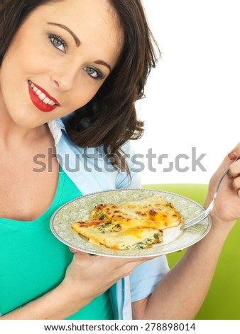 Beautiful Happy Smiling Young Woman in Her Twenties  Holding a Plate of Cannelloni Pasta - stock photo