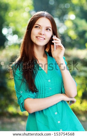 beautiful happy smiling young woman using mobile - stock photo