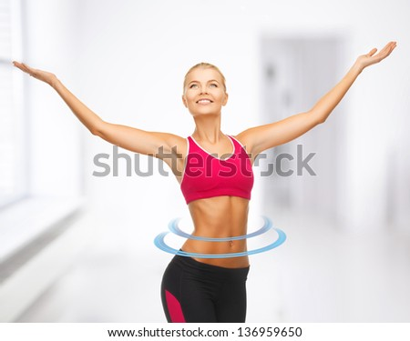 beautiful happy sportswoman with raised up hands - stock photo
