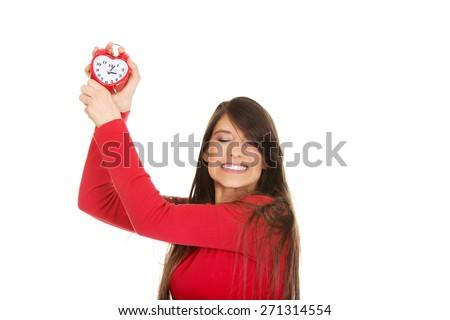 Beautiful happy student woman with alarm clock. - stock photo
