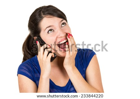 beautiful happy surprised latin young girl talking on her cell phone isolated on white - stock photo