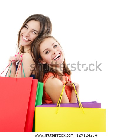 beautiful happy teen girls with colored shopping sale bags over white - stock photo