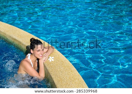 Beautiful happy woman enjoying relax in spa at resort pool. Relaxing outdoor jacuzzi. - stock photo