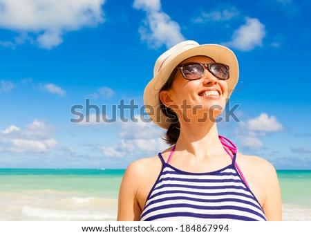 Beautiful happy woman enjoying summer on the beach. Lifestyle concept. - stock photo