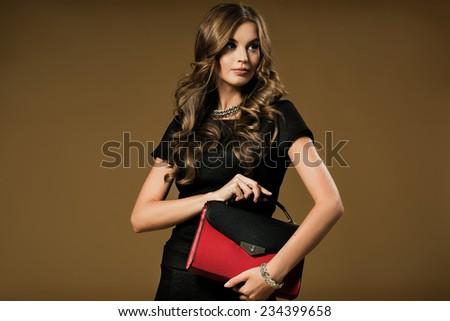 Beautiful happy woman holding a bag - stock photo