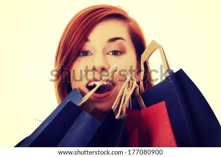 Beautiful happy woman  holding  shopping bags. - stock photo