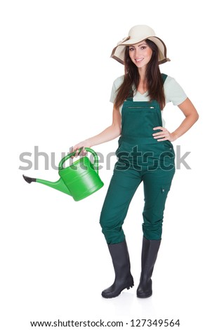 Beautiful Happy Woman Holding Watering Can. Isolated On White - stock photo
