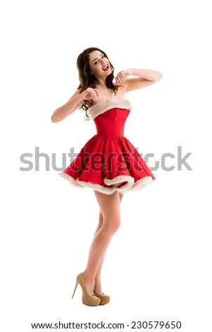 Beautiful happy woman in Santa Claus clothes - stock photo