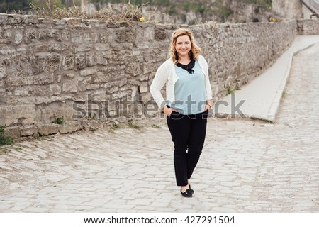 beautiful happy woman smiling and looking into the camera - stock photo