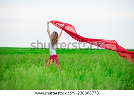 Beautiful happy woman walking  in the summer rural meadow. Outdoor summer portrait of pretty sport style woman jumping with fabric. Beautiful fit tan girl. Sexy slim model caucasian ethnicity outdoors - stock photo