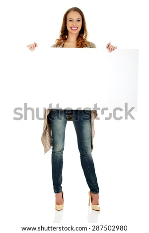 Beautiful happy woman with blank board. - stock photo