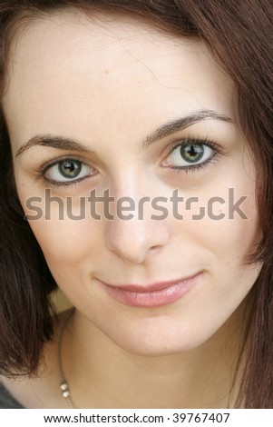 Beautiful happy woman with green eyes.