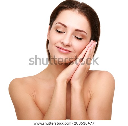 Beautiful happy woman with perfect clean skin and hands near the face. Closeup isolated model with closed eyes