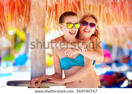 beautiful happy women, friends enjoy summer vacation on tropical beach