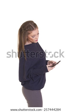 Beautiful happy young blond  woman using tablet computer , isolated on white