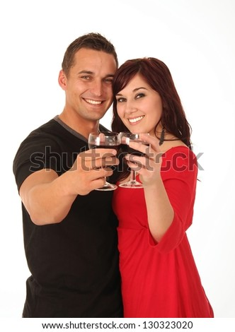 Beautiful happy young couple toasting with their glasses of wine