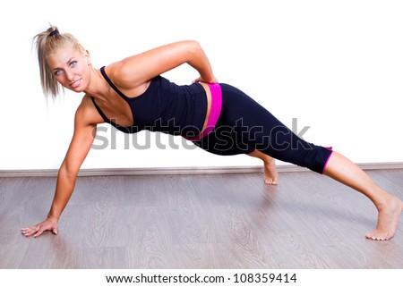 beautiful happy young woman doing push up - stock photo
