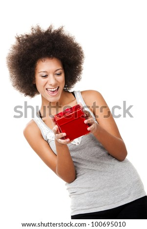 Beautiful happy young woman holding a red christmas gift, isolated on white - stock photo