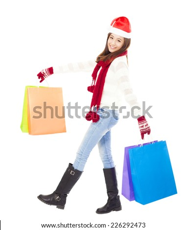 beautiful happy young woman holding shopping bags. Christmas shopping concept.