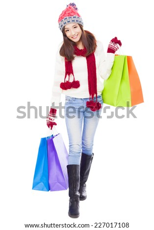 beautiful happy young woman holding shopping bags. Christmas shopping concept. - stock photo