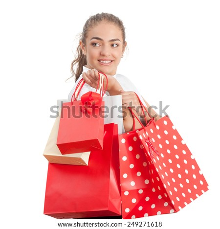 Beautiful Happy Young Woman Holding Shopping Bags. Red and White Colors.