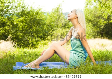 beautiful happy young woman in the park on a warm summer day