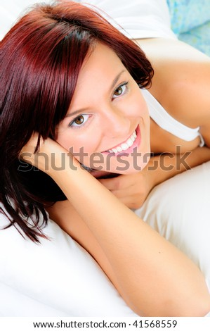 Beautiful Happy Young Woman Relaxing In Bed - stock photo