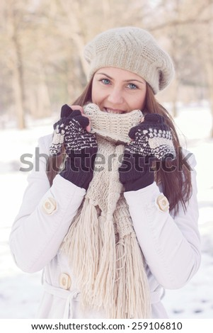 Beautiful Happy Young Woman Winter in the park.Caucasian female winter portrait outdoor. - stock photo