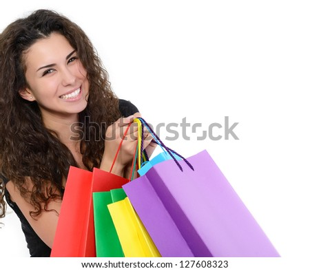 beautiful happy young woman with colored shopping bags over white