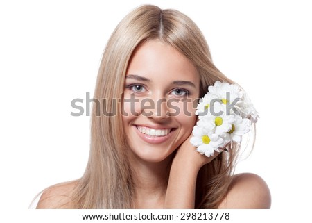 Beautiful happy young woman with flowers - stock photo