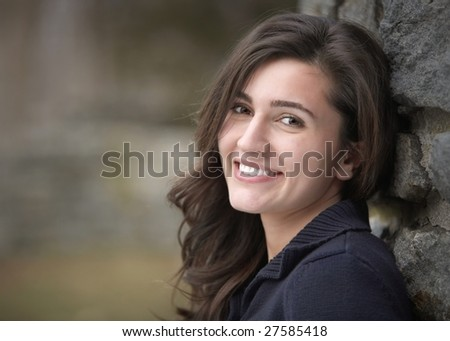 Beautiful happy young woman with friendly smile