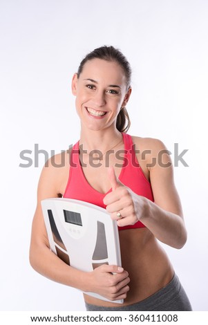 beautiful happy young woman with weight scale success weight loss - stock photo