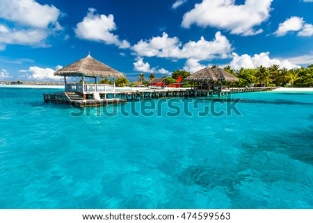 Beautiful harbor bridge in island of Maldives. Perfect tropical island paradise beach Maldives. Luxury summer travel holiday vacation background concept.