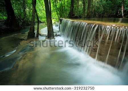 beautiful hauy mae kamin water falls in deep forest kanchanaburi western of thailand