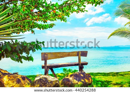 Beautiful Hawaii beach. Bench on the beach near the sea. Summer holiday and vacation concept. - stock photo