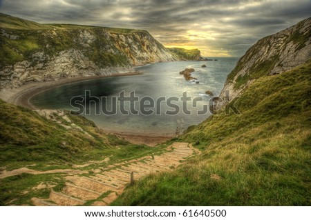 Beautiful HDR view of Man O War cove on Jurassic Coast in England - stock photo
