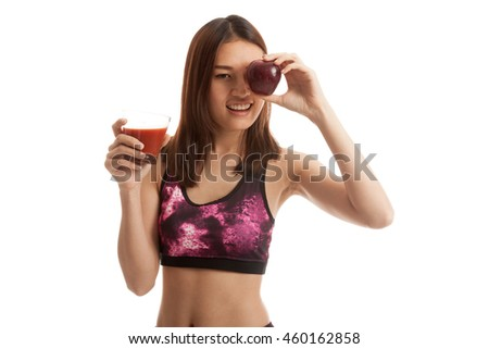 Beautiful healthy Asian girl with tomato juice and apple  isolated on white background. - stock photo