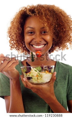 Beautiful healthy mixed Black Hispanic / Latin woman enjoying a fresh healthy salad isolated over white background