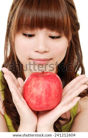 beautiful healthy serene girl with red apple - stock photo