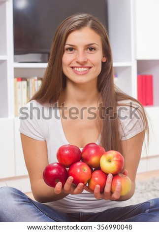 Beautiful Healthy Smiling Young Woman, hold organic apples - stock photo