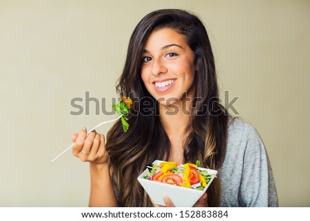 Beautiful healthy woman eating salad, Dieting Concept. Healthy Lifestyle.
