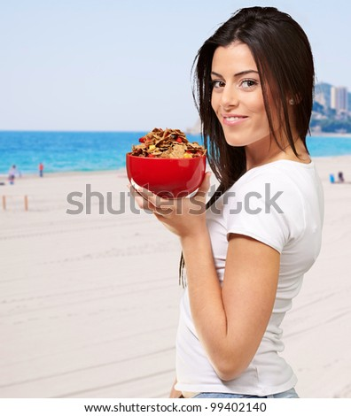 Beautiful Healthy Woman Holding Bowl Of Cornflakes - stock photo
