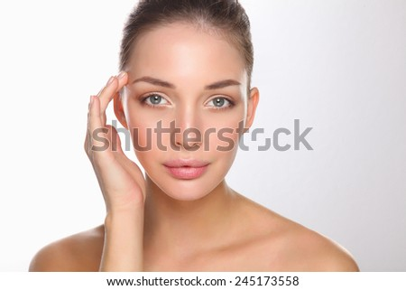 Beautiful healthy woman touching her skin, isolated - stock photo