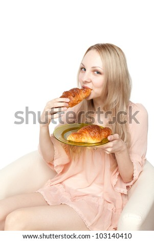 Beautiful healthy woman with croissant. Portrait of caucasian.
